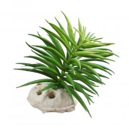 Mała sztuczna roślina na kamieniu z dziurkami do akwarium terrarium